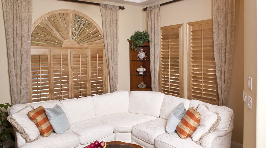 Arched Ovation Wood Shutters In Austin Living Room