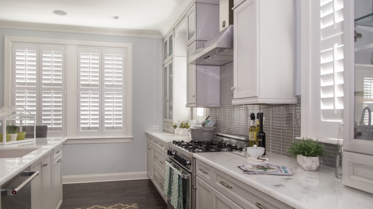 Plantation shutters in Austin kitchen with marble counter.
