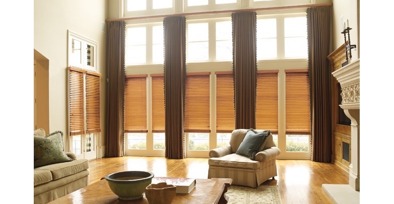 Austin great room with wooden blinds and floor to ceiling draperies.