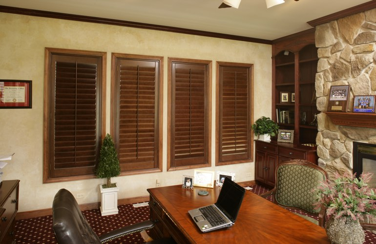 Hardwood plantation shutters in a Austin home office