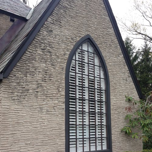 Exterior facade of brick home with plantation shutters