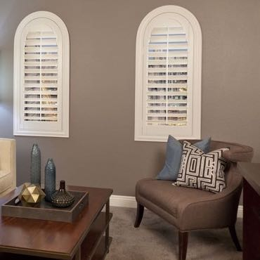 Austin family room arched shutters.