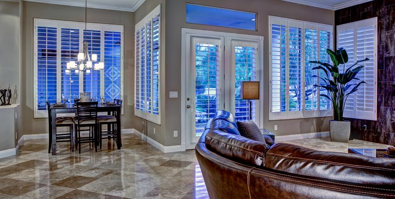 Austin great room with white shutters and modern lighting.