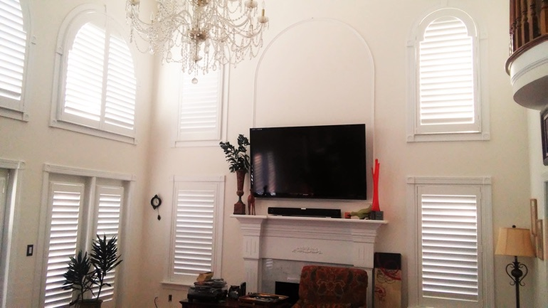 Austin great room with wall-mounted TV and arc windows.