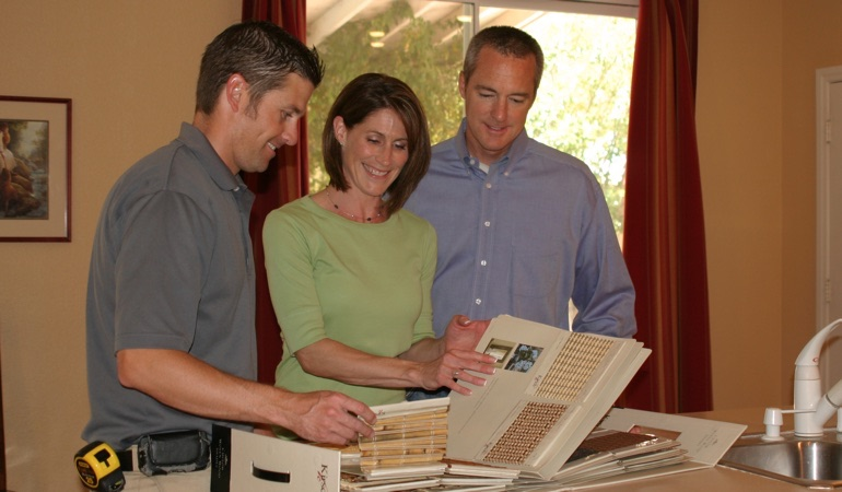 A couple looking at window treatment samples.