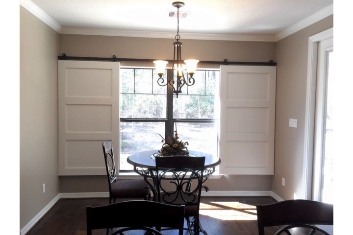 Austin dining room with classic barn door shutters.