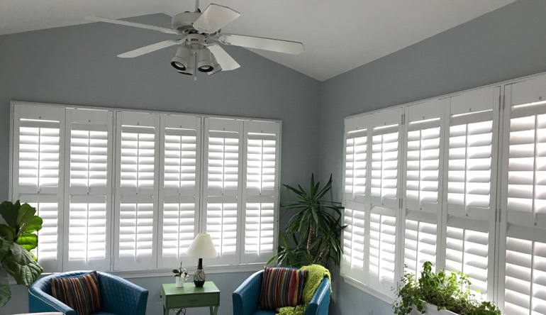 Austin living room with fan and shutters