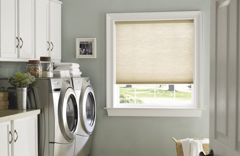Austin laundry room with pull-down window shades.