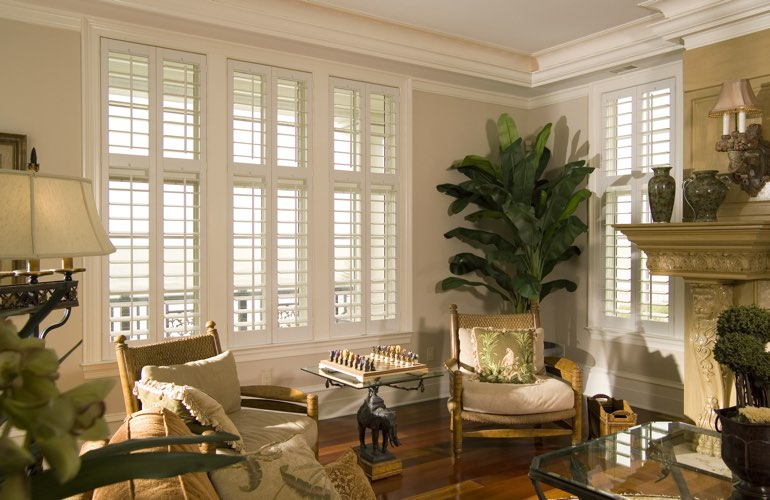 Living Room in Austin with polywood plantation shutters.
