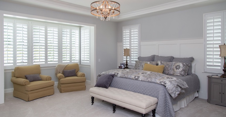 Plantation shutters in Austin bedroom.