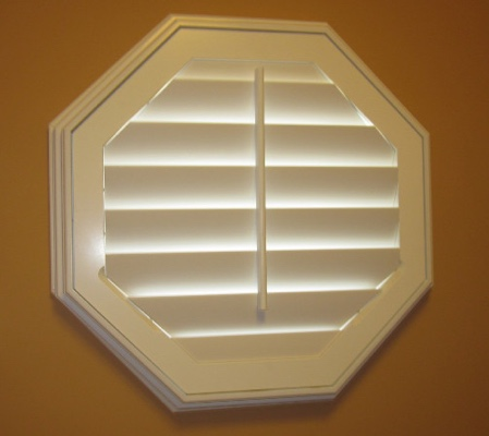 Austin octagon window with white shutter