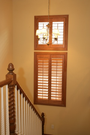 Ovation plantation shutters in tan staircase.