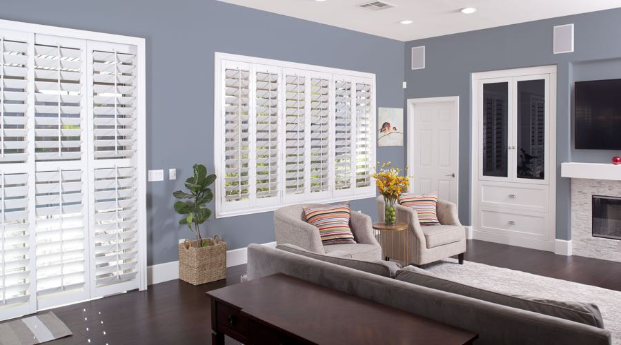 Faux Wood Shutters In pretty Austin Living Room