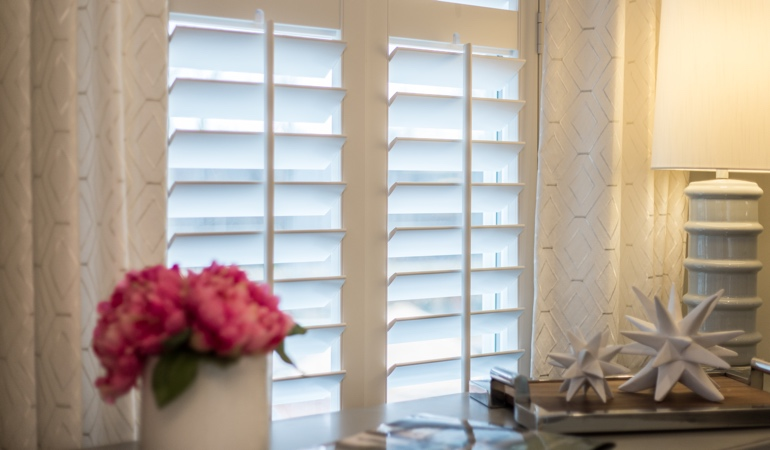 Plantation shutters by flowers in Austin