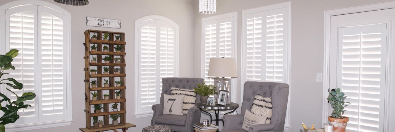 Plantation shutters over a couch