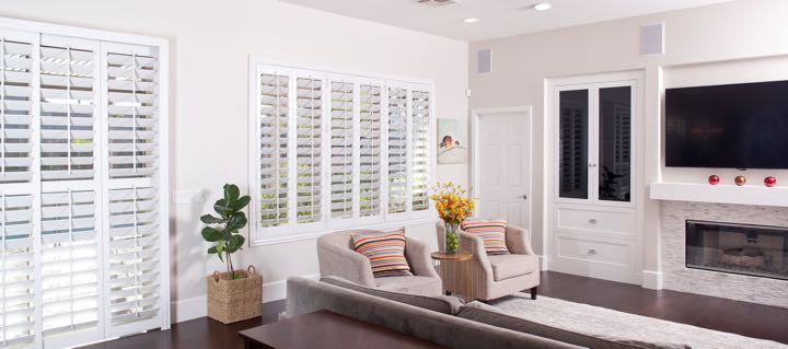 Austin living room in white with plantation shutters.