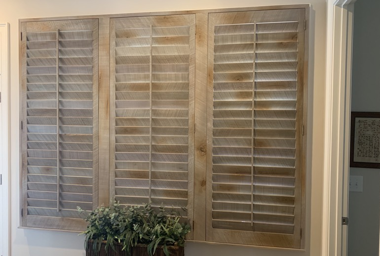 Closed reclaimed wood shutters in Austin