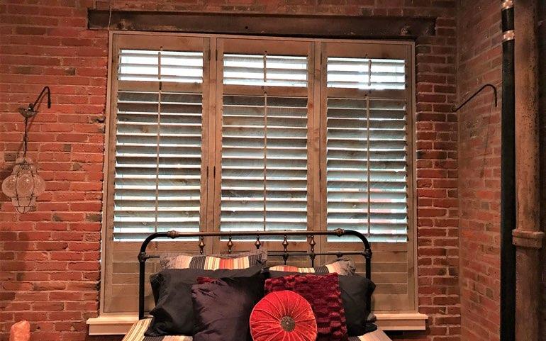 repurposed wood shutters in Austin bedroom - Reclaimed Wood Shutters For Sale Sunburst Shutters Austin, TX