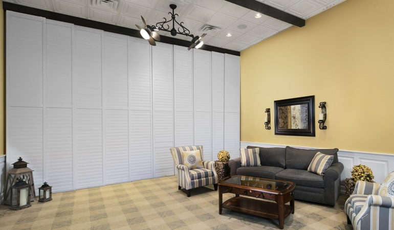 Plantation shutters as a room divider for a business