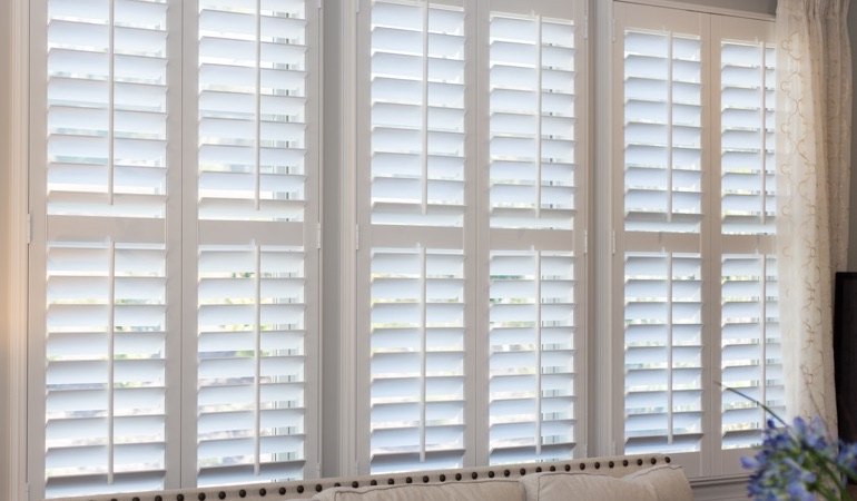 Faux wood plantation shutters in Austin