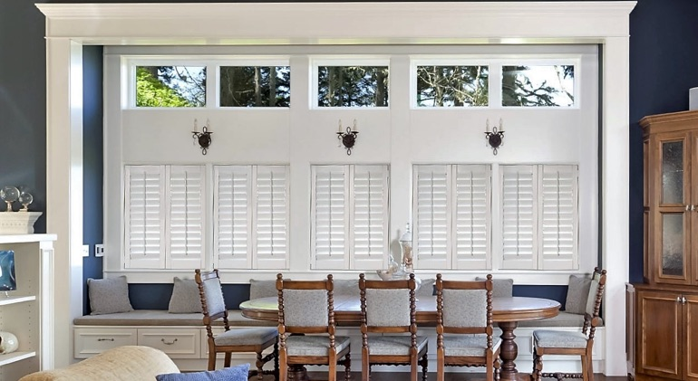 Austin great room with white plantation shutters.