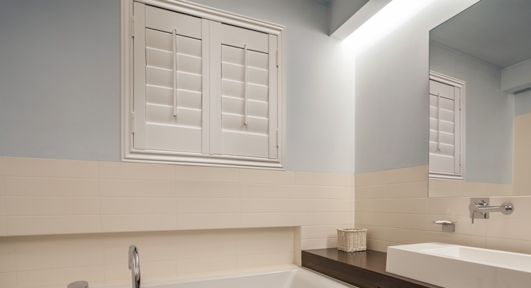 White waterproof shutters in Austin bathroom.