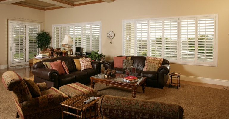 Austin sunroom with white shutters.