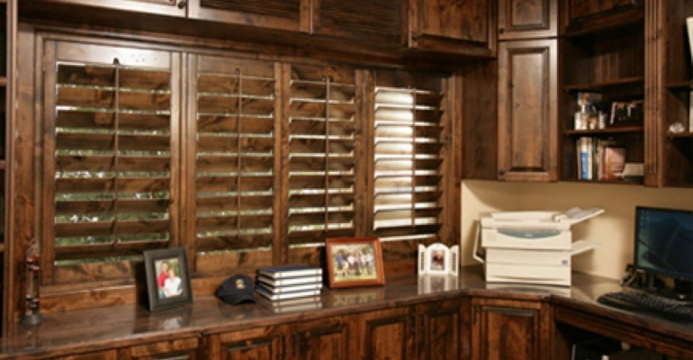 Wood Ovation shutters in home office.