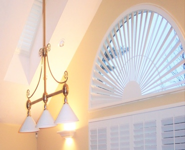 Austin arched eyebrow window with classic shutter