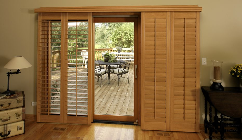 Delightful Bypass Wood Patio Door Shutters In A Austin Living Room