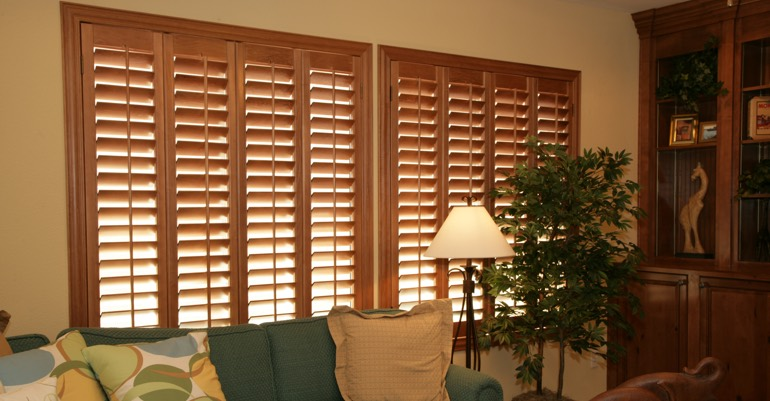 Natural wood shutters in Austin living room.