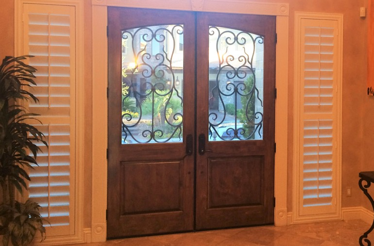 Sidelight window shutters in Austin foyer