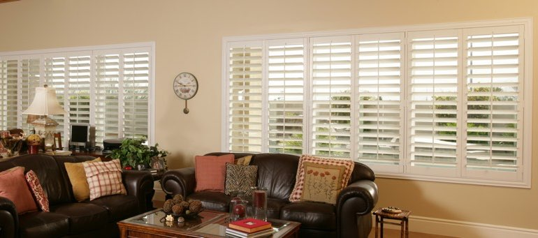 Wide window with white shutters in Austin living room